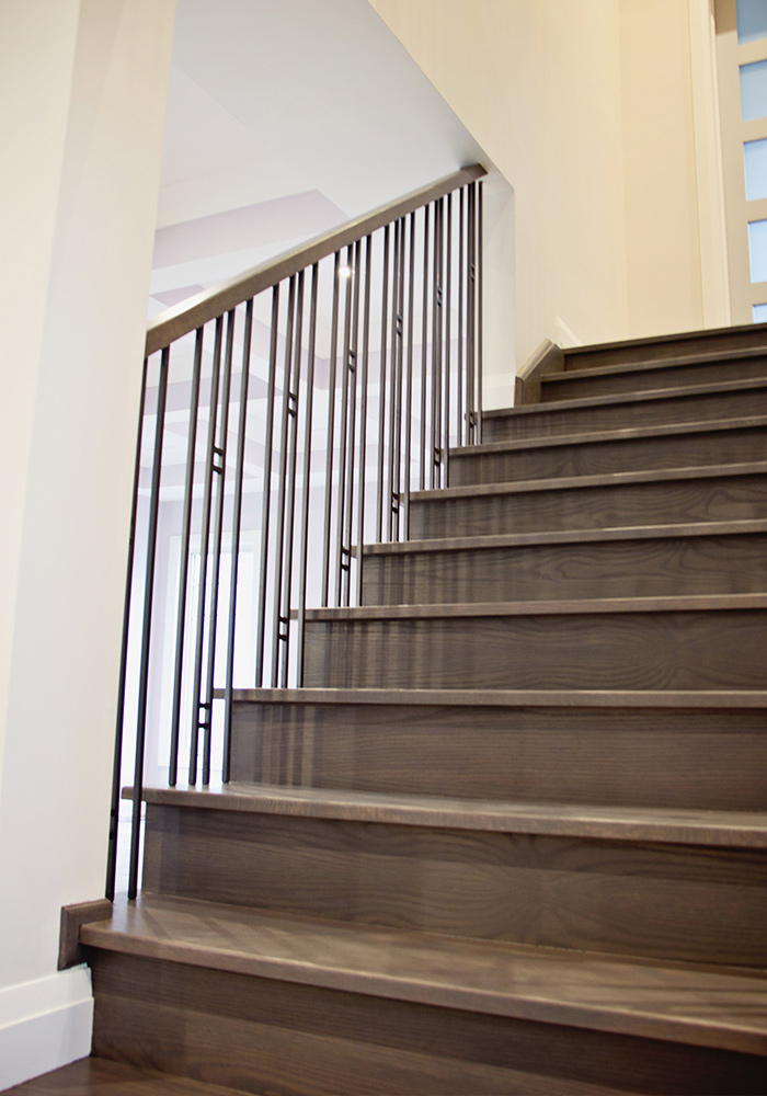 looking up view of stairs and railings with metal spindles