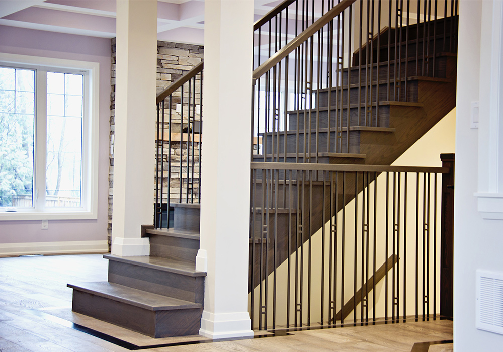 stairs and railings with white columns and metal spindles
