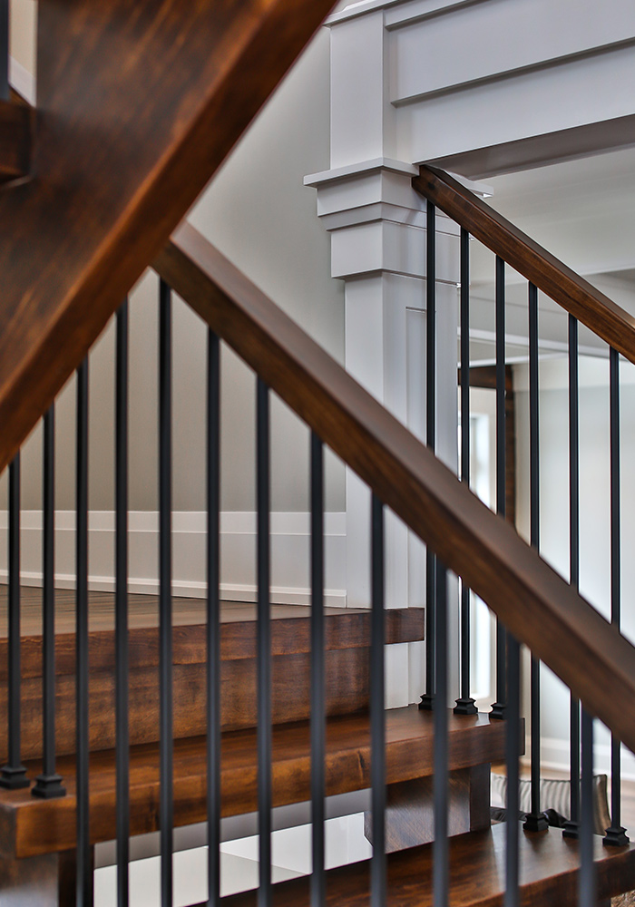 dark wood stairs and railings with metal spindles